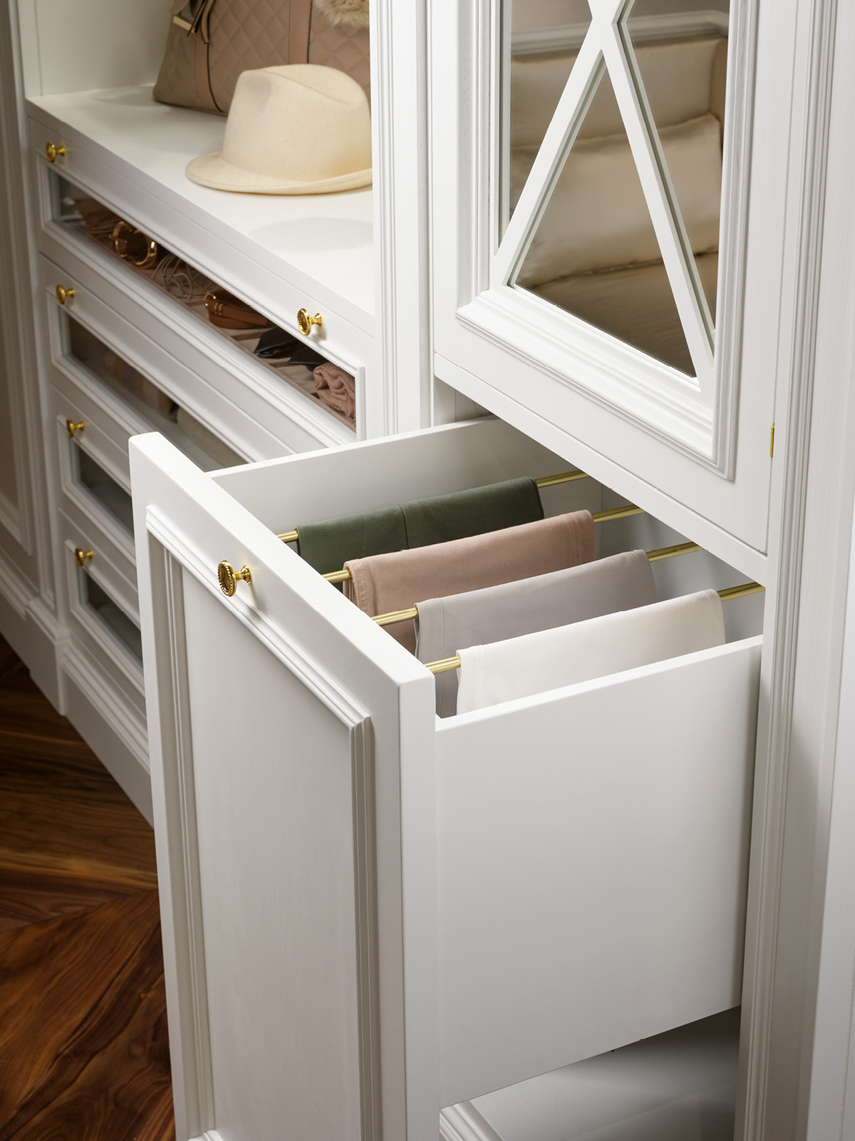 Detail of pull out drawer with pants holder