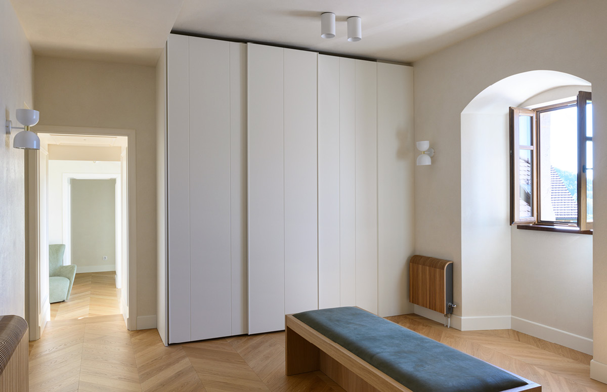 Walk in closet painted in white