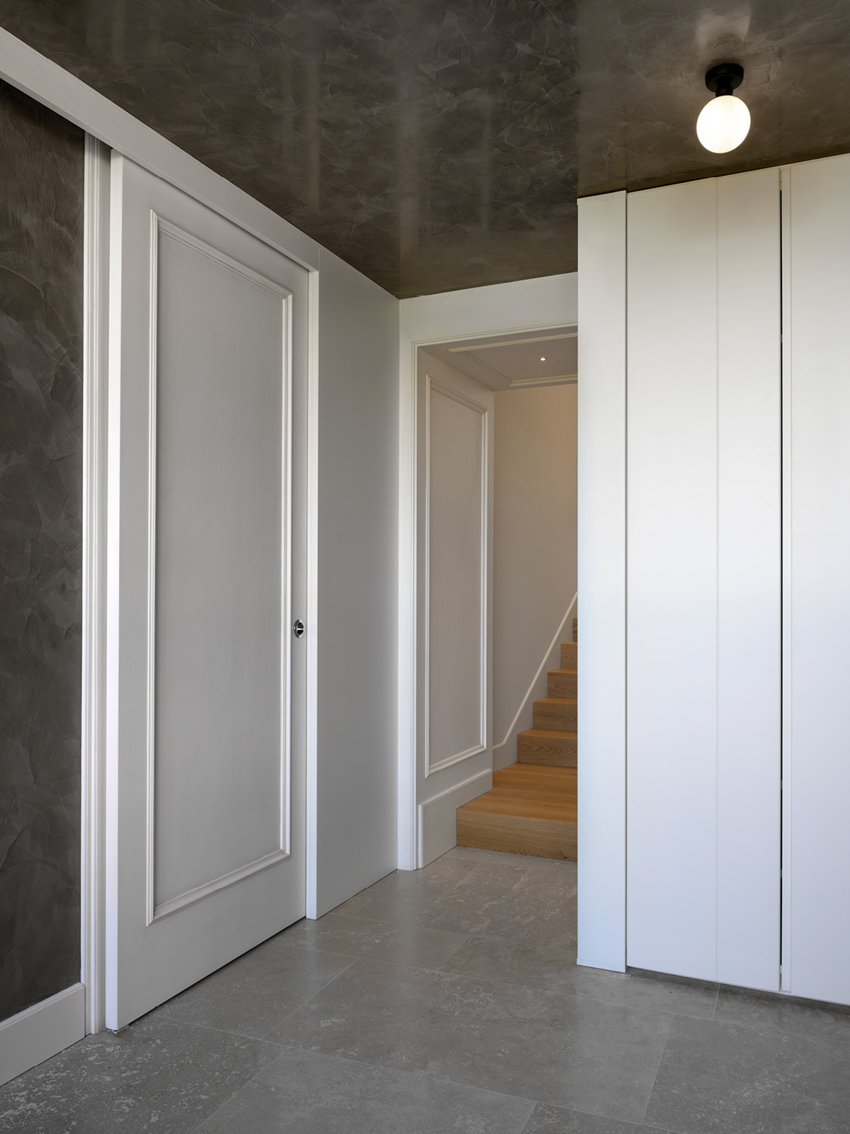 Detail of plain armoire painted in white
