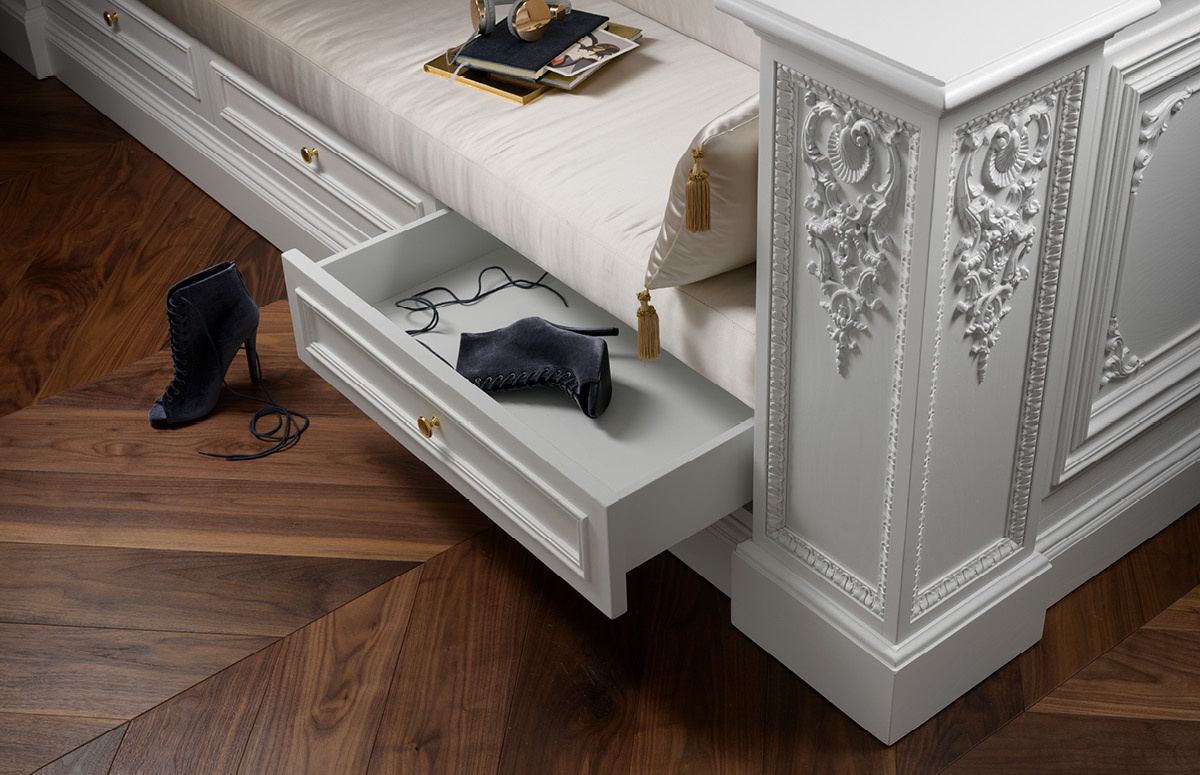 Detail on the internal side with  upholstered bench and drawers at the base